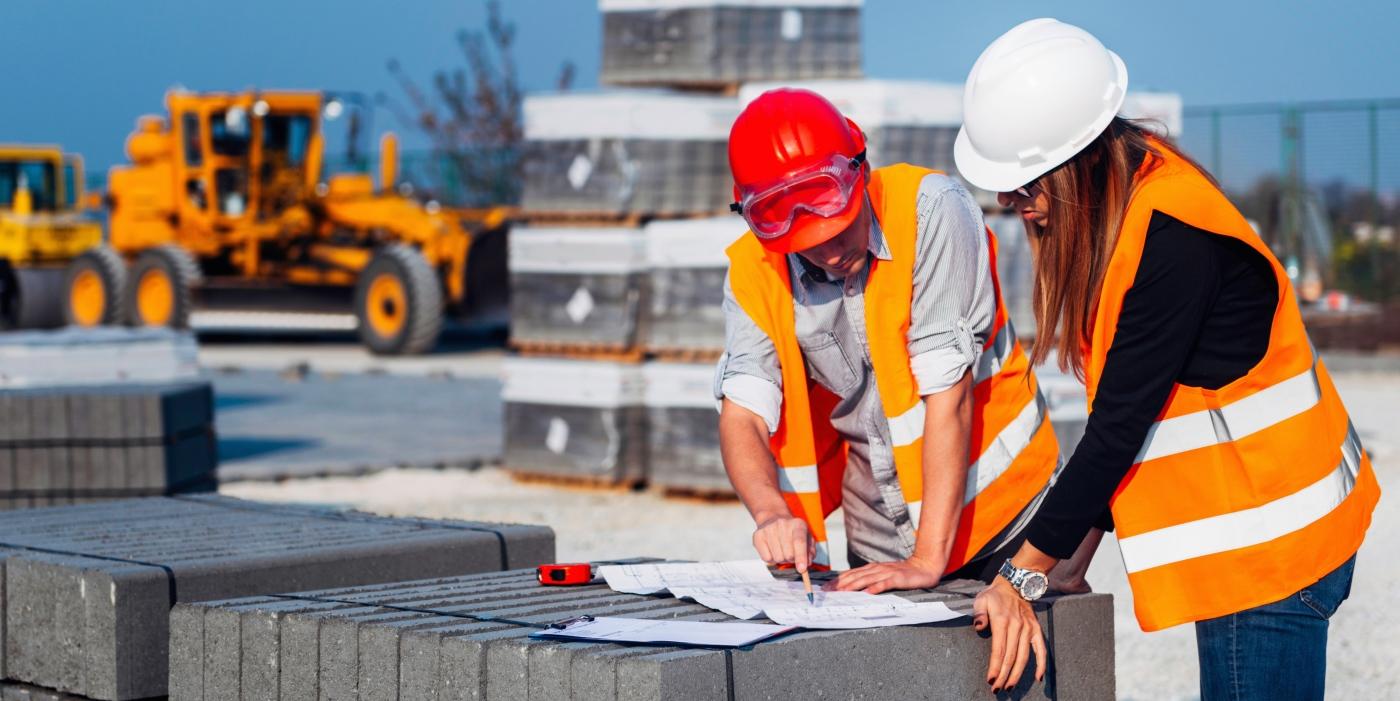 Engineers looking plans